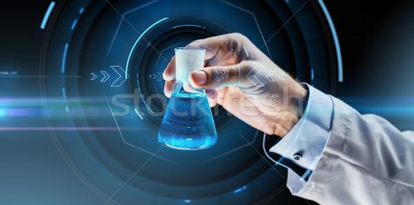 Közelkép tudós tart flaska vegyi tudomány Stock fotó © dolgachov