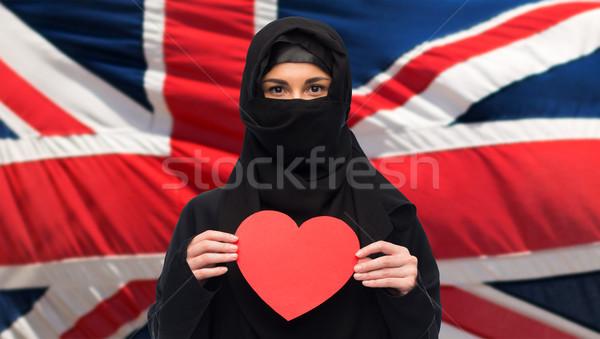 muslim woman in hijab holding red heart Stock photo © dolgachov