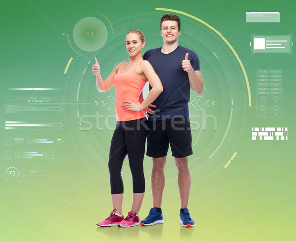 happy sportive man and woman showing thumbs up Stock photo © dolgachov