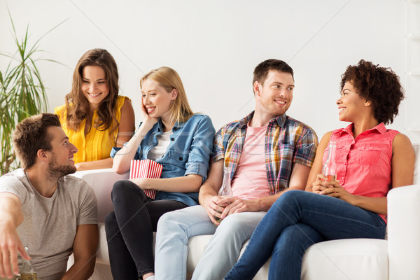 happy friends with popcorn and beer at home Stock photo © dolgachov