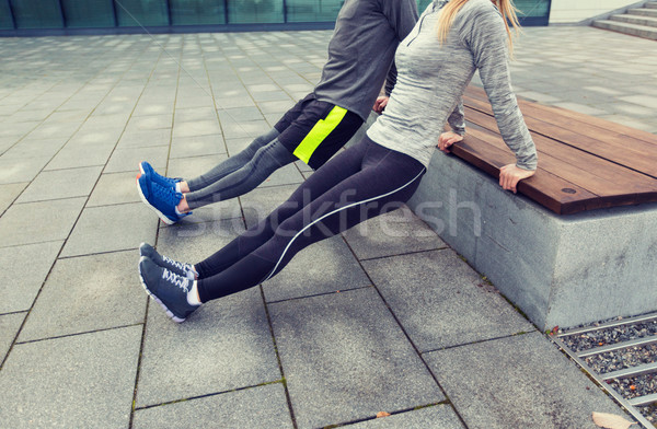 close up of couple doing triceps dip on bench Stock photo © dolgachov