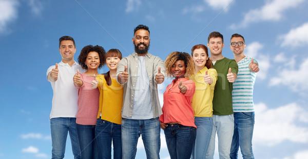 international group of people showing thumbs up Stock photo © dolgachov
