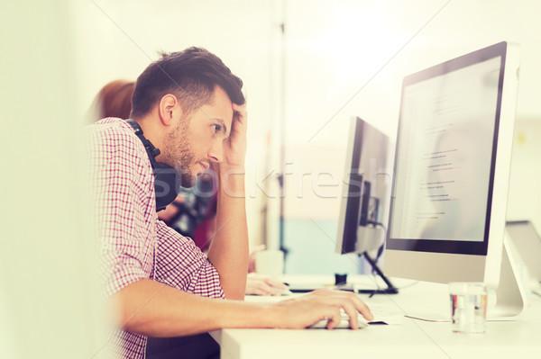 stressed software developer at office Stock photo © dolgachov