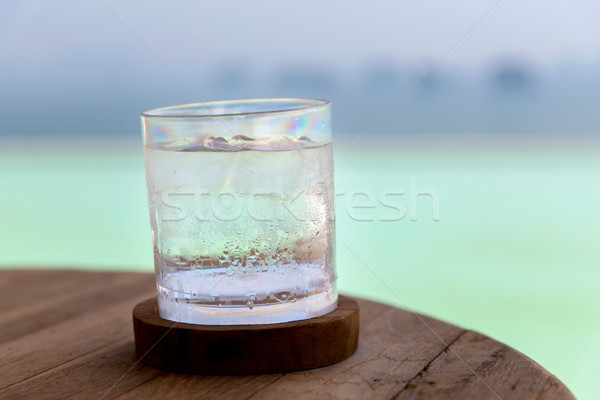 glass with cold water or cocktail on bar table Stock photo © dolgachov