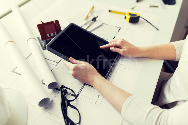 close up of hand with blueprint and tablet pc Stock photo © dolgachov