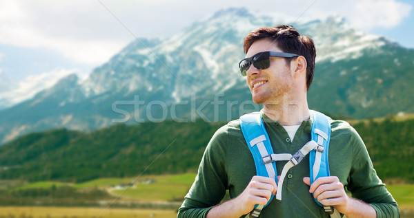 happy man with backpack traveling in highlands Stock photo © dolgachov