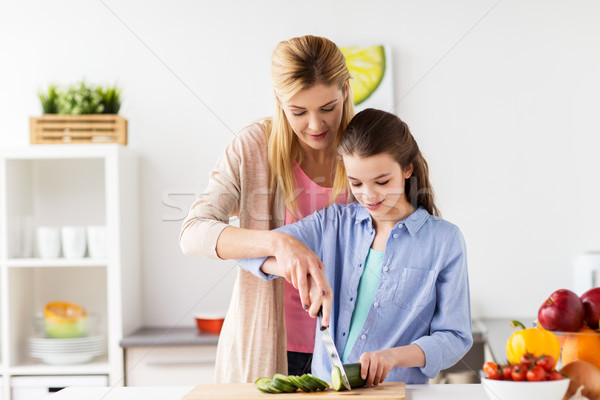 happy family cooking dinner at home kitchen Stock photo © dolgachov