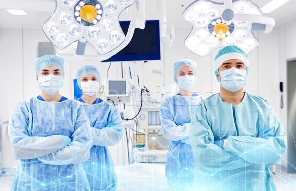 Grupo cirujanos sala de operaciones hospital cirugía medicina Foto stock © dolgachov
