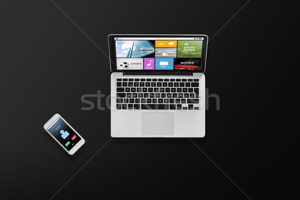 laptop computer with media and smartphone top view Stock photo © dolgachov