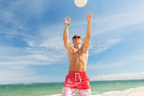 Moço bola jogar voleibol praia verão Foto stock © dolgachov