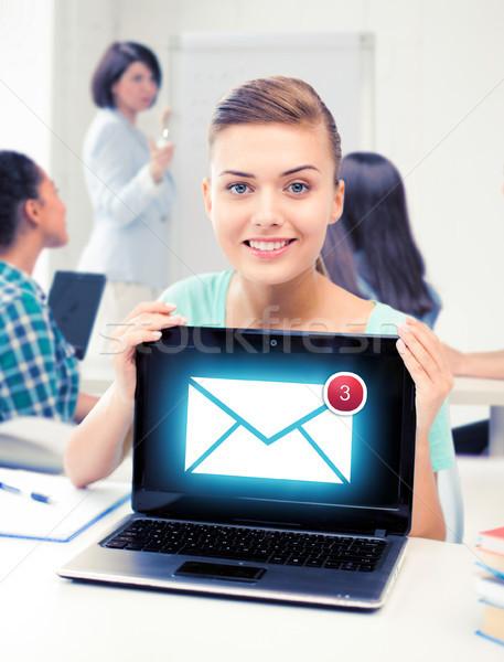 Lány tart laptop email felirat iskola Stock fotó © dolgachov