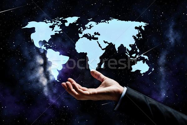 close up of businessman hand with world map Stock photo © dolgachov