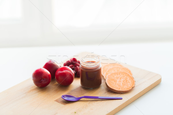 fruit puree or baby food in jar and feeding spoon Stock photo © dolgachov