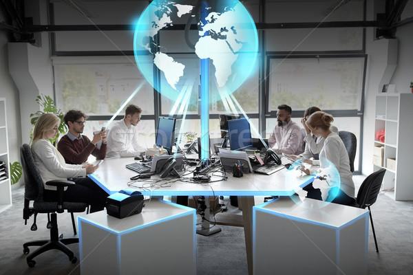 ビジネスチーム 地球 ホログラム オフィス グローバル ネットワーク ストックフォト © dolgachov