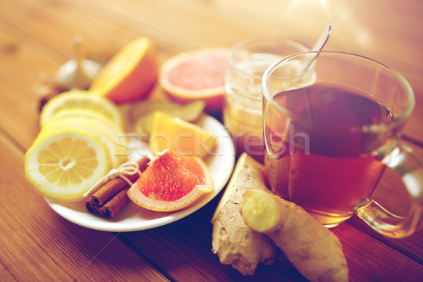ginger tea with honey, citrus and cinnamon on wood Stock photo © dolgachov