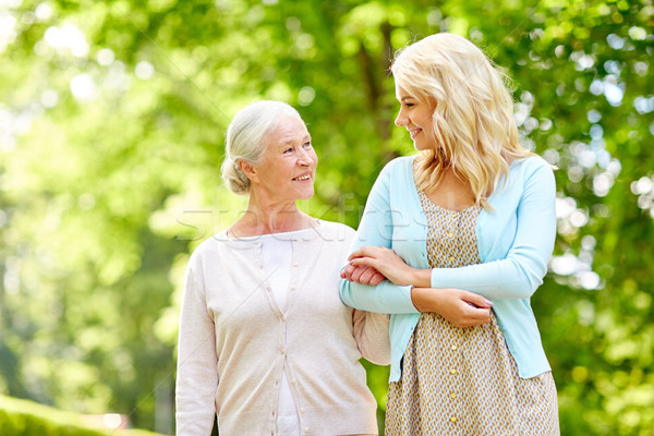 Stock photo: daughter with senior mother at park