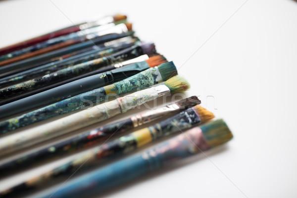 close up of dirty paintbrushes Stock photo © dolgachov