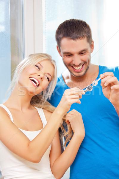 Mutlu çift tuşları parlak resim odak Stok fotoğraf © dolgachov