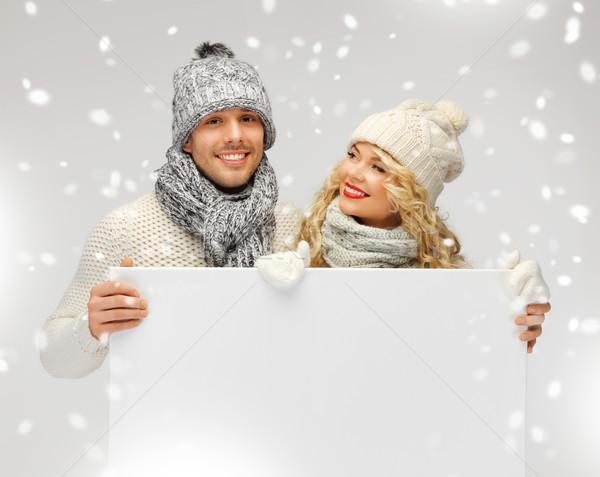 Couple hiver vêtements bord photos Photo stock © dolgachov
