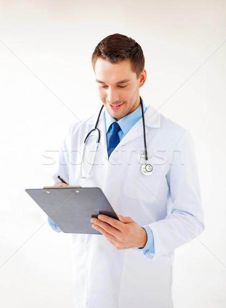 male doctor writing prescription Stock photo © dolgachov