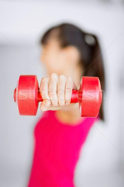 スポーティー 女性 手 光 赤 ダンベル ストックフォト © dolgachov
