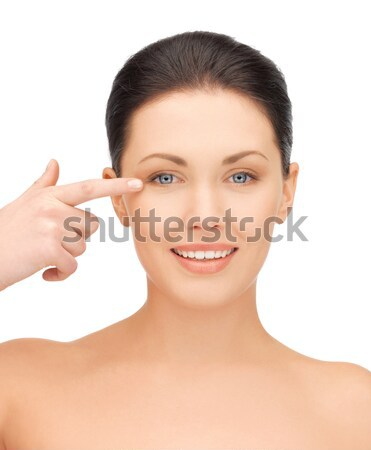 young calm woman pointing to her cheek Stock photo © dolgachov