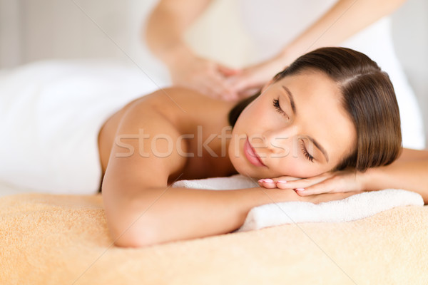 Stock photo: beautiful woman in spa salon getting massage