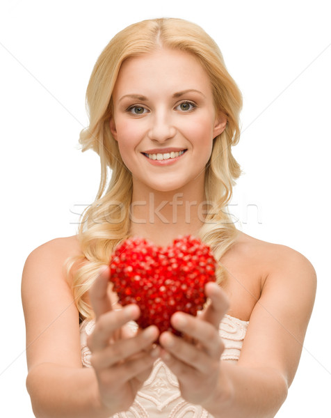 Stock photo: smiling woman giving small red heart