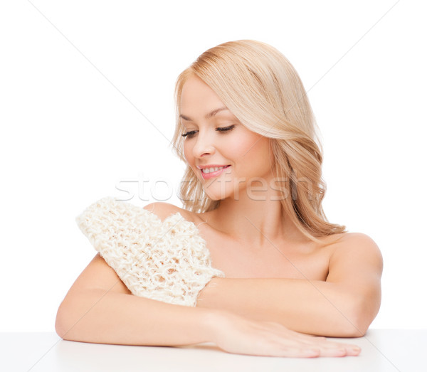 Stock photo: smiling woman with exfoliation glove