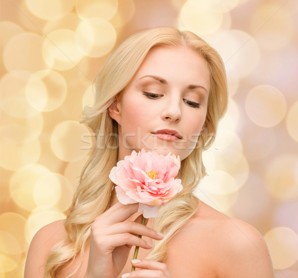 Stock photo: lovely woman with peony flower