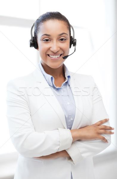 african helpline operator with headphones Stock photo © dolgachov