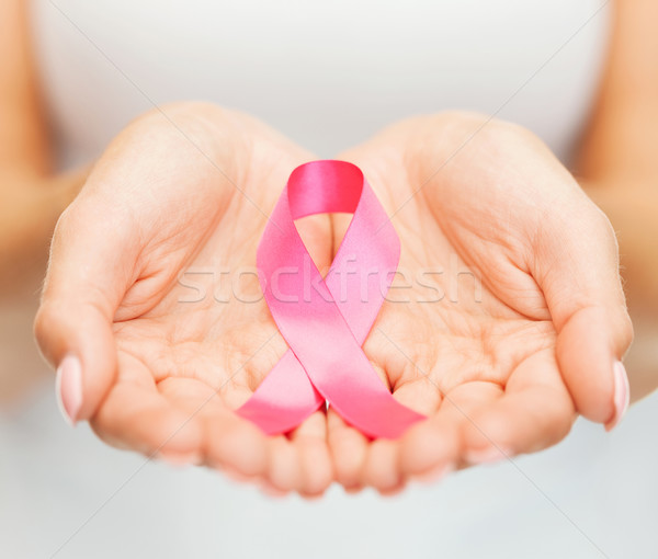 Stock photo: hands holding pink breast cancer awareness ribbon