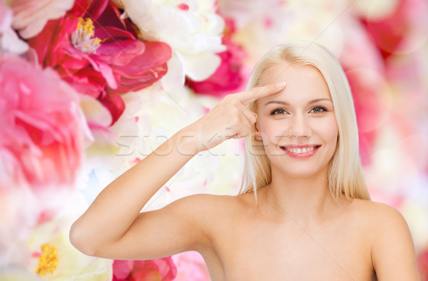 beautiful woman touching her forehead Stock photo © dolgachov