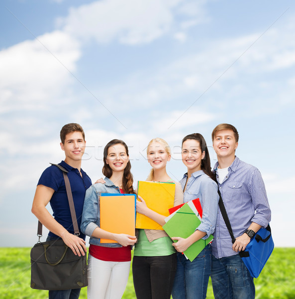 group of smiling students standing Stock photo © dolgachov