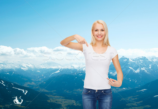 smiling young woman in blank white t-shirt Stock photo © dolgachov