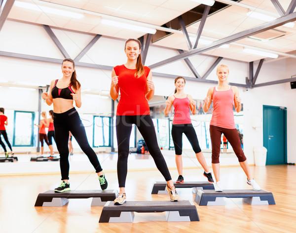 Grup gülen kadın aerobik uygunluk spor Stok fotoğraf © dolgachov