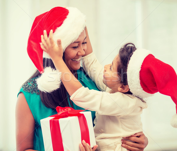 happy mother and child girl with gift box Stock photo © dolgachov