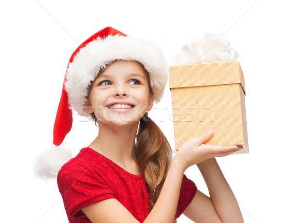 Sorridente menina ajudante seis caixa de presente Foto stock © dolgachov