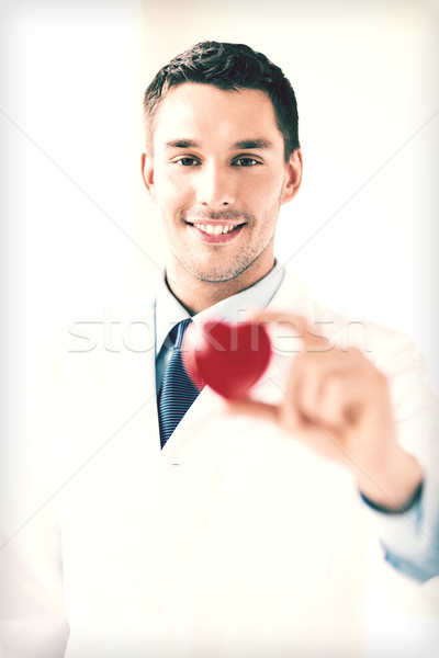 male doctor with heart Stock photo © dolgachov