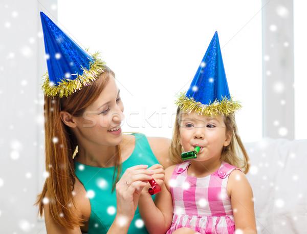 Anya lánygyermek buli sapkák szívesség agancs Stock fotó © dolgachov