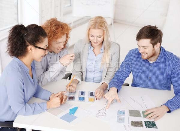 smiling creative team looking at sketch Stock photo © dolgachov