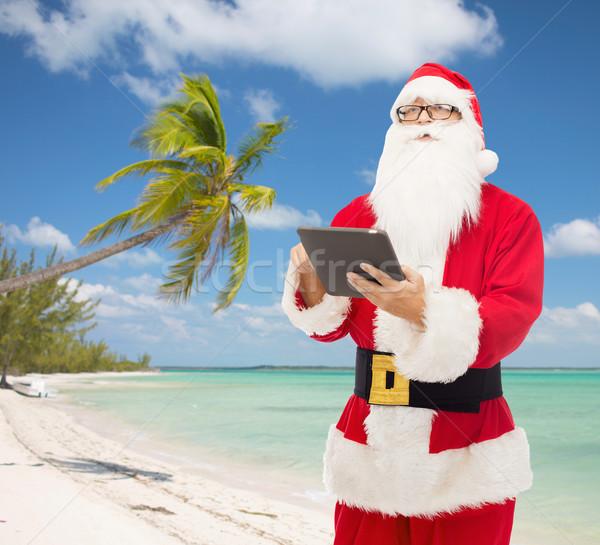 Homem traje papai noel natal férias Foto stock © dolgachov