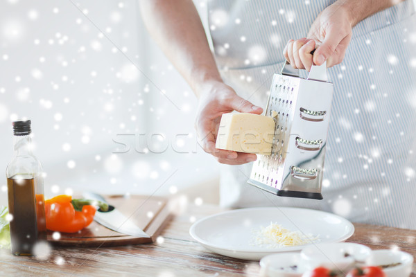 close up of male hands with grater grating cheese Stock photo © dolgachov