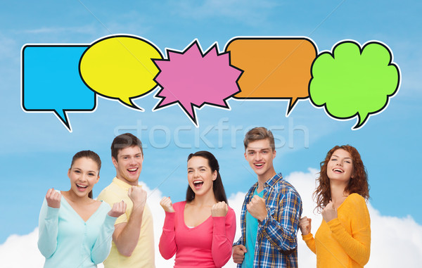 group of smiling teenagers showing triumph gesture Stock photo © dolgachov