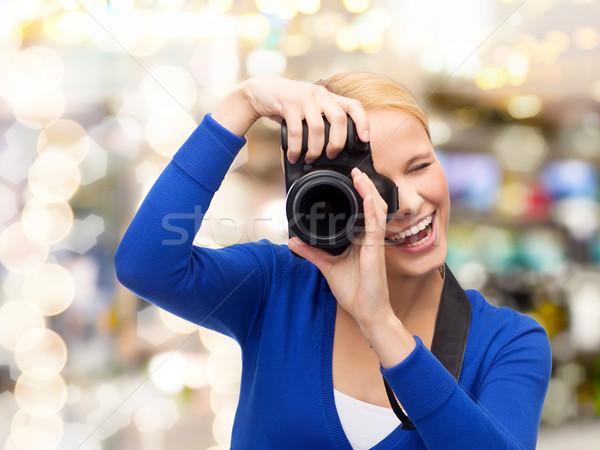 улыбающаяся женщина фотография цифровая камера фотографии технологий Сток-фото © dolgachov