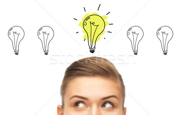 Femme regarder éclairage idée affaires Photo stock © dolgachov