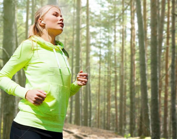happy woman running or jogging Stock photo © dolgachov