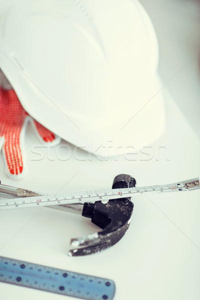 blueprint, flexible ruller, helmet and hammer Stock photo © dolgachov