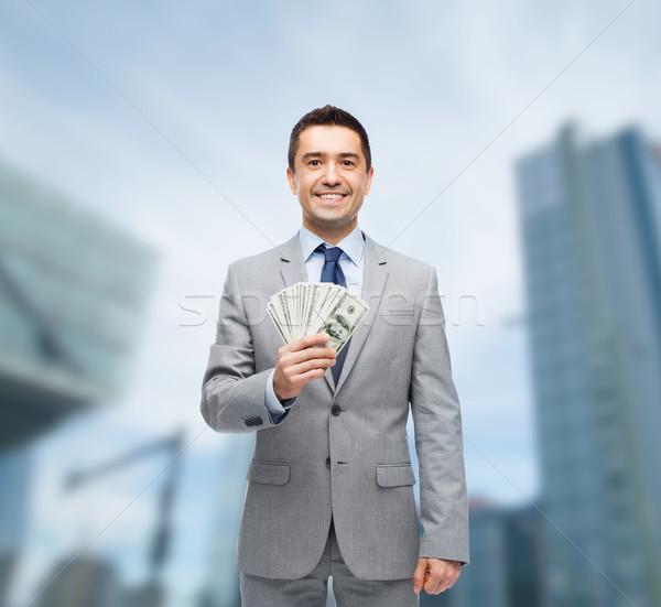 smiling businessman with american dollar money Stock photo © dolgachov