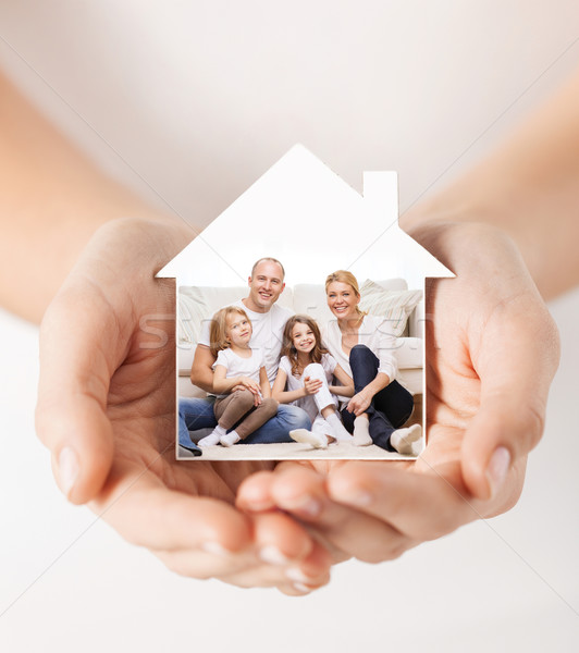 close up of hands holding house shape with family Stock photo © dolgachov